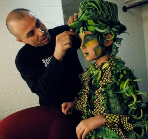 Cirque Dreams Jungle Fantasy Wardrobe Supervisor George Pires, left, helps Alex Swader, 9, complete his transformation into a tap-dancing grasshopper backstage at the Birmingham Jefferson Convention Complex concert hall. (Tamika Moore)