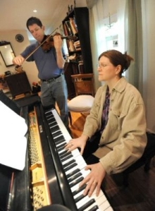 Alex Dean, left, and his wife, Lori, met in the U.S. Air Force Band. Alex continues playing violin in the band, while Lori is a stay-at-home mom and teaches piano to College of Southern Maryland students.