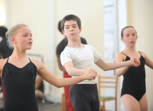 Bradley Dean, center, 13, practices five times a week or more at The Ballet Arts Academy at the Old Waldorf School.
