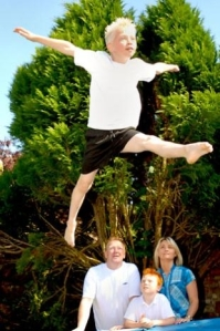 William Mitchell, eight, shows his ballet skills to his family , 2009