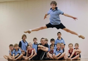 John Moore, 11, shows off his leap for Adrian Burnett and the rest of the boys' class at Tamworth's Owl and Pussycat dance school 2009