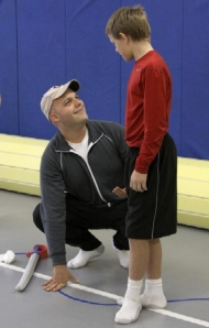 Mick Gunter, left, works with young dancer Austin Hawkins, 12, during the Centralia Ballet Academy's boys-only ballet class 2009