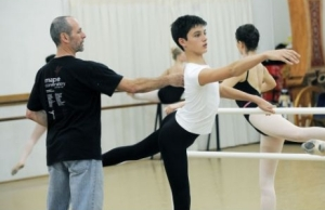 Charles Maple, director of Maple Conservatory of Dance, instructs Patrick Frenette not to pinch his shoulder blades together while practicing an Arabesque. Maple says Patrick has a bright future ahead in ballet.