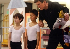 Ballet Master Otto Neubert, right, Darren Huang (center) and Tayler Nguyen, rehearse the party scene for PNB's Nutcracker 2012