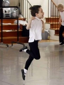Curtis Daniel, 5, of Salem, leaps through the air, during a boys ballet class at American Ballet Academy 2013