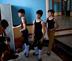 Identical triplets, from center left, Marcos, Cesar and Angel Ramirez Castellanos prepare for their ballet class at the National School of Ballet in Havana, Cuba 2013