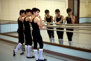 Identical triplets Marcos, Cesar and Angel Ramirez Castellanos stand at the barre at the start of ballet class at the National School of Ballet in Havana, Cuba 2013