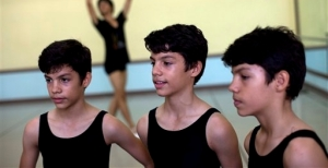 identical triplets Marcos, left, Cesar, center, and Angel Ramirez Castellanos stand together before their ballet class at the National School of Ballet in Havana, Cuba 2013