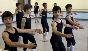Identical triplets Marcos, left, Cesar, second from right, and Angel Ramirez Castellanos, right, attend their ballet dance class at the National School of Ballet in Havana, Cuba 2013