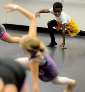 Tray Taylor, 11, rehearses at Power & Grace School of Performing Arts (photo by Val Horvath Davidson) 2013