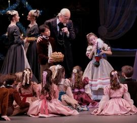 "Lleyton Ho (Nutcracker prince), Robert La Fosse (Herr Drosselmeier), and Claire Abraham (Marie) in Balanchine's ""Nutcracker,"" at New York City Ballet (photo by Paul Kolnik) 2013"
