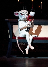 The mischievous little mouse (Justin Souriau-Levine, 10) holds the nutcracker doll in ABT's Nutcracker 2010