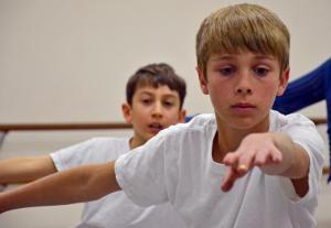 Caleb Ballentine, 12, during a ballet class at the Amherst Ballet (Yoshitaka Hamada) 2014-02