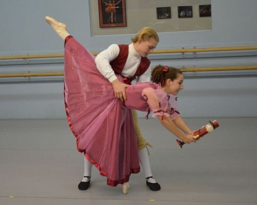 Eden Johnson-Woods and J.T. Herndon perform a scene from The Nutcracker. I thought I would never like it, but I'd venture a guess it's even harder than football, J.T. says of ballet. (Sarah Lane,The Washington Post) 2015