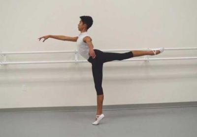 Anthony Rhee-Reynoso, 15, in Arabesque during a warm up at Juline School of Dance
