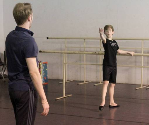 Pierson Feeney, 11, works with ballet instructor Vasily Lunde during a rehearsal at the Gulf Coast School of Performing Arts (John Fitzhugh, Sun Herald) 2016